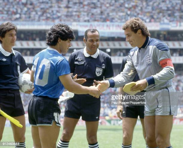 England captain Peter Shilton shakes hands with Diego Maradona of Argentina watched by referee Ali Bennaceur prior to the FIFA World Cup quarter...