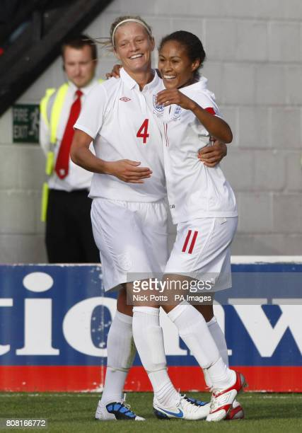 England captain Rachel Yankey celebrates with Katie Chapman after scoring the opening goal on her100th cap during the Women's World Cup Qualifying...