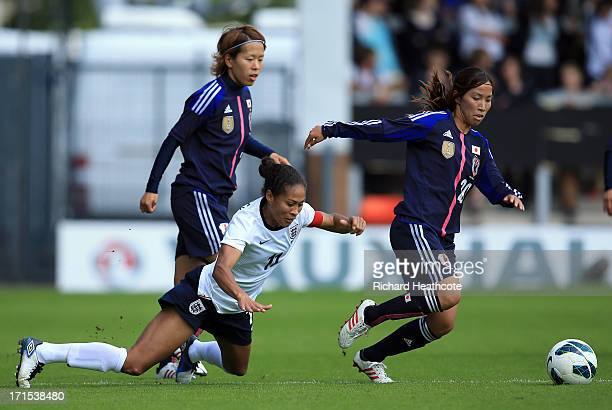 England captain Rachel Yankey is tackled by Emi Nakajima of Japan during the Women's International match between England and Japan at the Pirelli...