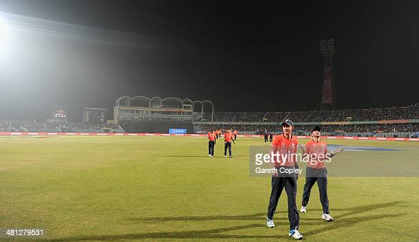 England captain Stuart Broad leaves the field as floodlight failure stops play during the ICC World Twenty20 Bangladesh 2014 Group 1 match between...