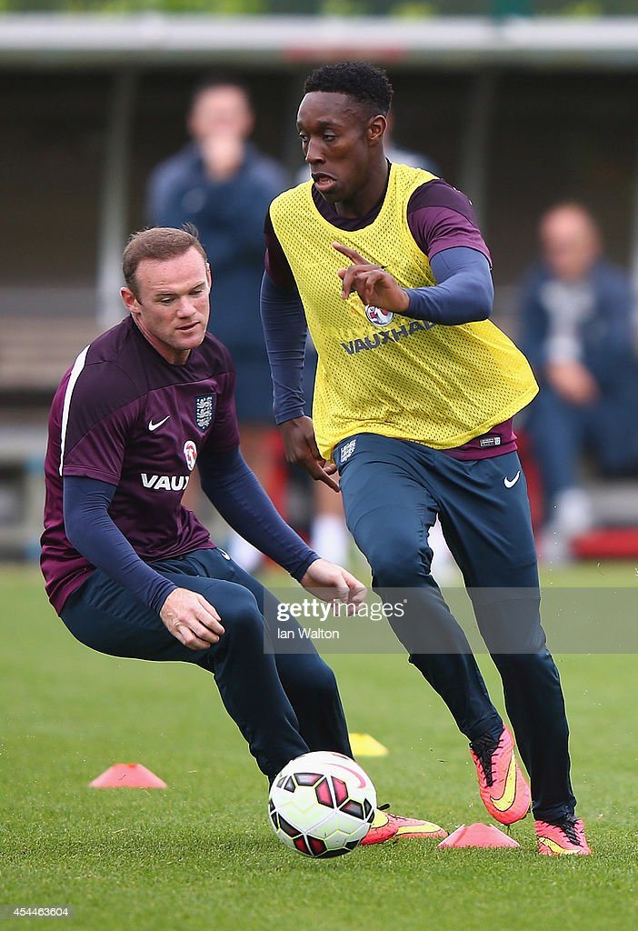 England captain Wayne Rooney tries to tackles Danny Welbeck during a England training session before the international friendly match against Norway at London Colney on September 1, 2014 in London, England.