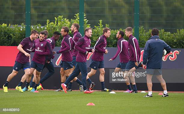 England captain Wayne Rooney warms up with members of the England squad during a England training session before the international friendly match...