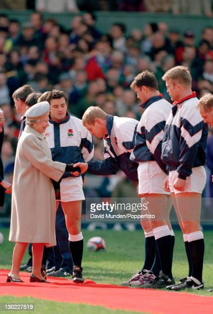 England captain Will Carling introduces Dean Richards to Her Majesty Queen Elizabeth II before the Rugby Union International against Wales at...