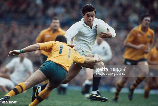 England captain Will Carling is tackled by David Campese of Australia during the rugby union international match between England and Australia at...