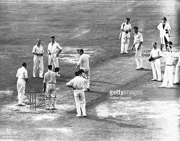 England captain Yardley leads his team in applause for Australian captain Donald Bradman, who is playing his last ever Test Match, as he comes out to...