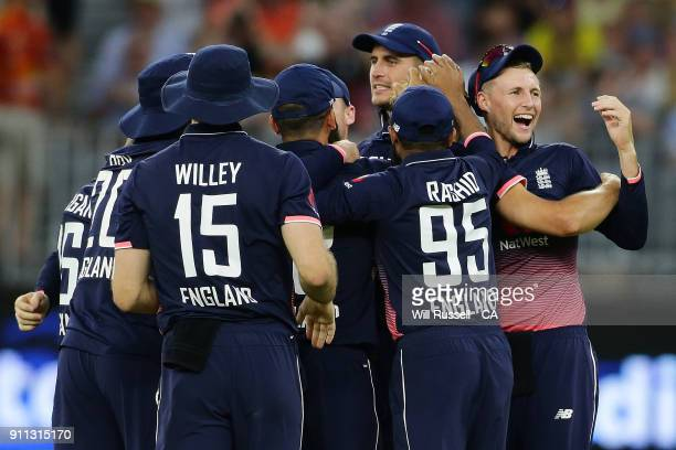 England celebrate after defeating Australia during game five of the One Day International match between Australia and England at Perth Stadium on...