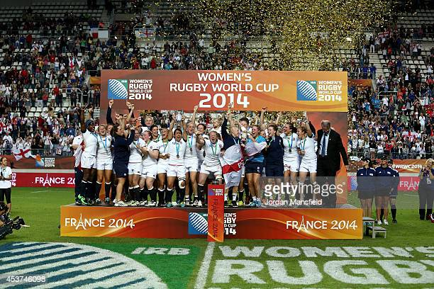 England celebrate after winning the IRB Women's Rugby World Cup 2014 Final between England and Canada at Stade JeanBouin on August 17 2014 in Paris...