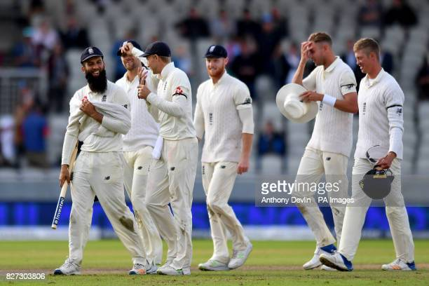 England celebrate as South Africa's Duanne Olivier is caught by England's Ben Stokes off the bowling of Moeen Ali as England win the test match...