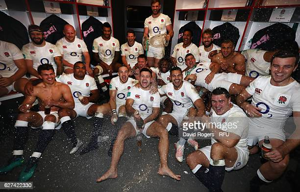 England celebrate in the dressing room after their victory during the Old Mutual Wealth Series match between England and Australia at Twickenham...