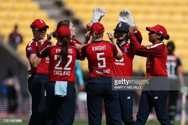 England celebrate New Zealand's captain Sophie Devine being caught during the third women's Twenty20 cricket match between New Zealand and England in...