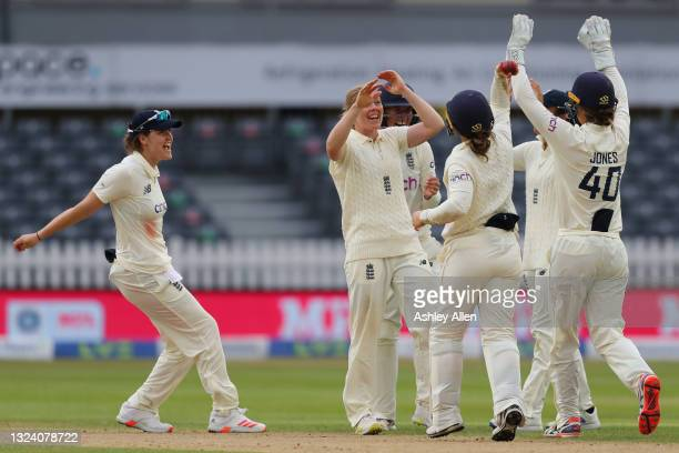 England celebrate the wicket of India's Punam Raut on Day Two of the LV= Insurance Test Match between England Women and India Women at Bristol County...