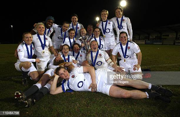 England celebrate their Grand Slam win after their victory in the Womens Six Nations match between Ireland and England at Ashbourne Rugby Club on...