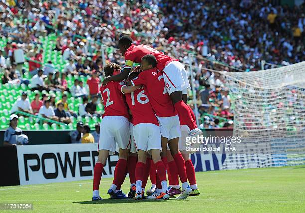 England celebrate their second goal during the FIFA U17 World Cup Group C match between Uruguay and England at Estadio Torreon on June 25 2011 in...