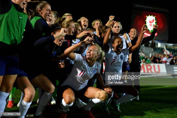 England celebrate victory at the final whistle during the Women's World Cup qualifier between Wales Women and England Women at Rodney Parade on...