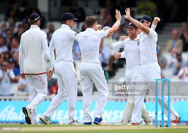 England celebrate with Jonny Bairstow of England after he catches out Sarfraz Ahmed of Pakistan during day three of the 4th Investec Test between...