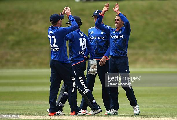 England celebrate with Max Holden of England after getting the wicket of Wanidu Hasaranga of Sri Lanka during the Royal London OneDay Series match...