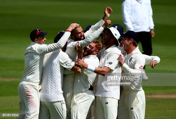 England celebrate with Moeen Ali after he takes the final wicket of Morne Morkel of South Africa during day five of the 3rd Investec Test match...