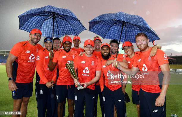 England celebrate with the series trophy after winning the 3rd Twenty20 International match between England and West Indies at Warner Park on March...