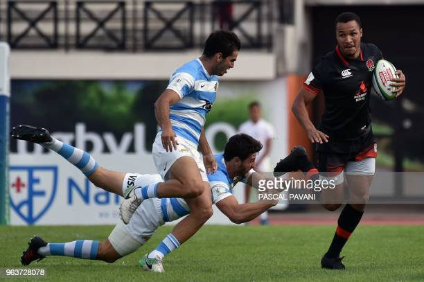 England centre Jordan Olowofela breaks away during the U20 World Rugby Championship match between England and Argentina at Parc des sports et de...