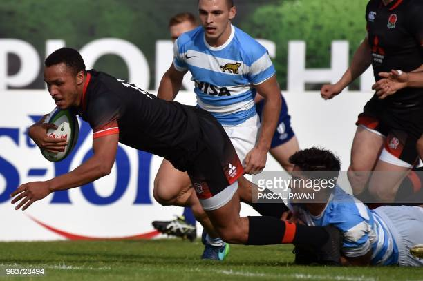 England centre Jordan Olowofela scores a try during the U20 World Rugby Championship match between England and Argentina at Parc des sports et de...