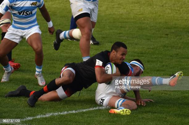 England centre Jordan Olowofela vies with Argentina' s n°8 Juan Bautista Pedemonte during the U20 World Rugby Championship match between England and...
