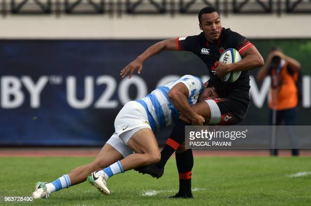England centre Jordan Olowofela vies with Argentina's centre Juan Pablo Castro during the U20 World Rugby Championship match between England and...