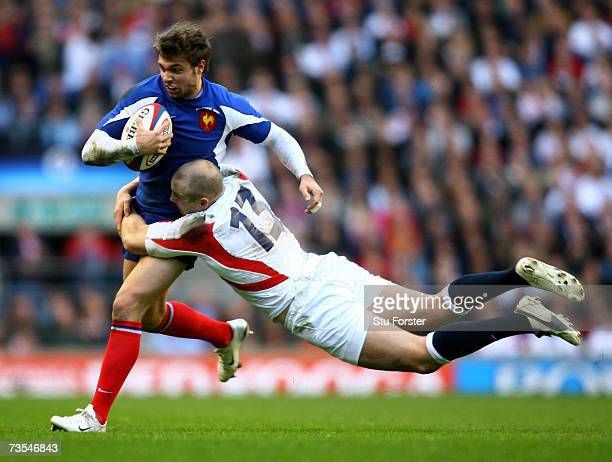 England centre Mike Tindall tackles French winger Vincent Clerc during the RBS Six Nations Game between England and France at Twickenham on March 11...
