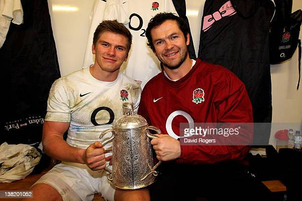 England centre Owen Farrell and his father and assistant England coach coach Andy Farrell pose with the Calcutta Cup following their team's 136...