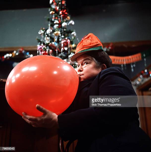 England Circa 1960's Actress Violet Carson who plays the role of Ena Sharples in the television series Coronation Street is pictured blowing up a...