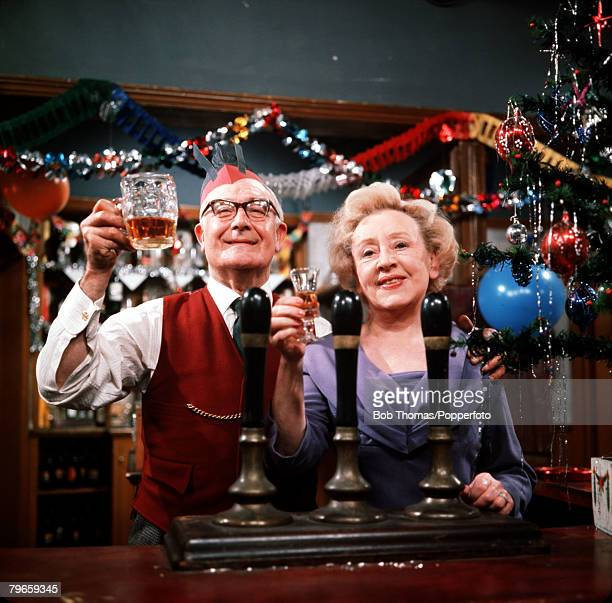 England Circa 1960's Annie Walker played by Doris Speed and television husband Jack Walter played by Arthur Leslie are pictured behind the bar of the...