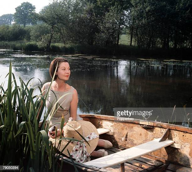 England Circa 1960's British actress Vivien Leigh is pictured on the lake at Tickerage Mill