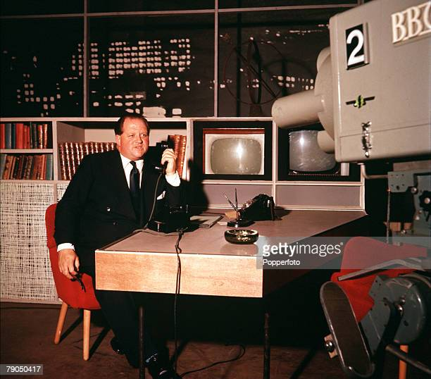 England Circa 1960's British television broadcaster Richard Dimbleby is pictured being filmed by a television camera
