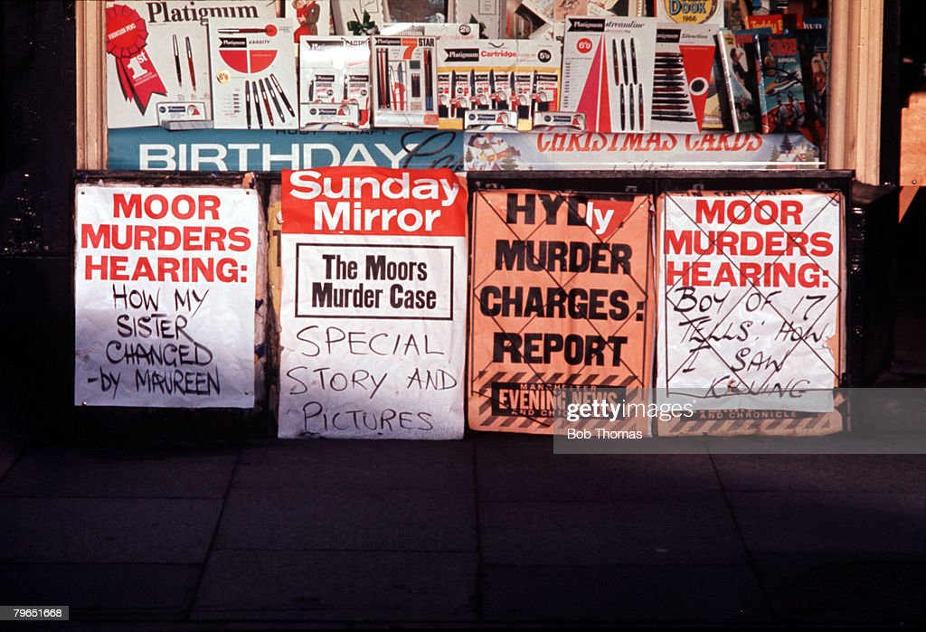 England, Circa 1965, Newspaper headlines telling of the Moors Murders court hearings are pictured outside a newspaper shop during the trial of Myra Hindley and Ian Brady : News Photo