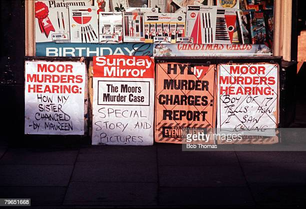 England Circa 1965 Newspaper headlines telling of the Moors Murders court hearings are pictured outside a newspaper shop during the trial of Myra...