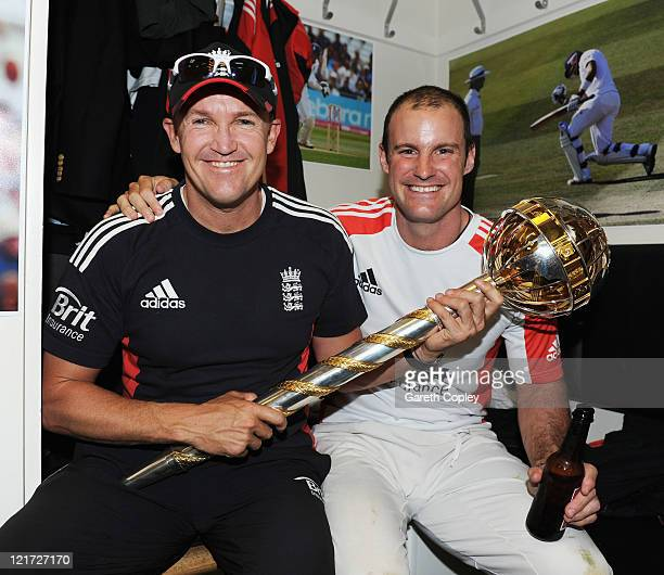 England coach Andy Flower and captain Andrew Strauss celebrate the series victory with the ICC Test Championship Mace in the dressing room as England...