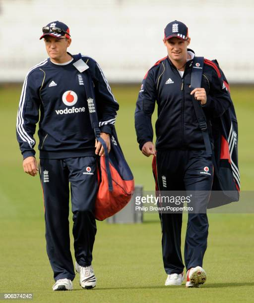 England coach Andy Flower and captain Andrew Strauss walk to a training session before the 1st Test match between England and West Indies at Lord's...