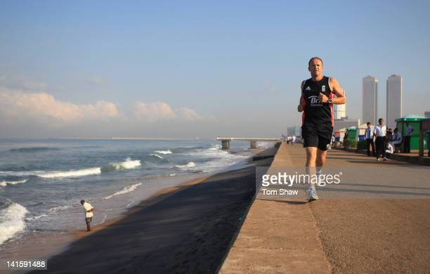 England Coach Andy Flower goes for a run as part of his training for the London Marathon on the seafront on March 19 2012 in Colombo Sri Lanka