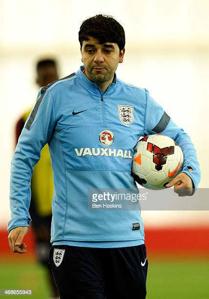 England coach Dan Micciche looks on ahead of a U16 International match between England and Spain at St Georges Park on February 9 2014 in...