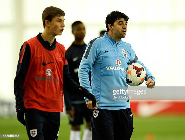 England coach Dan Micciche takes the warm up ahead of a U16 International match between England and Spain at St Georges Park on February 9 2014 in...