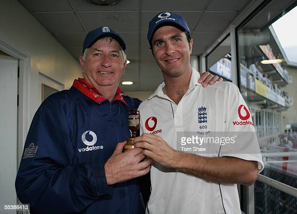 England coach Duncan Fletcher and captain Michael Vaughan pose with the Ashes urn during day five of the Fifth npower Ashes Test match between...