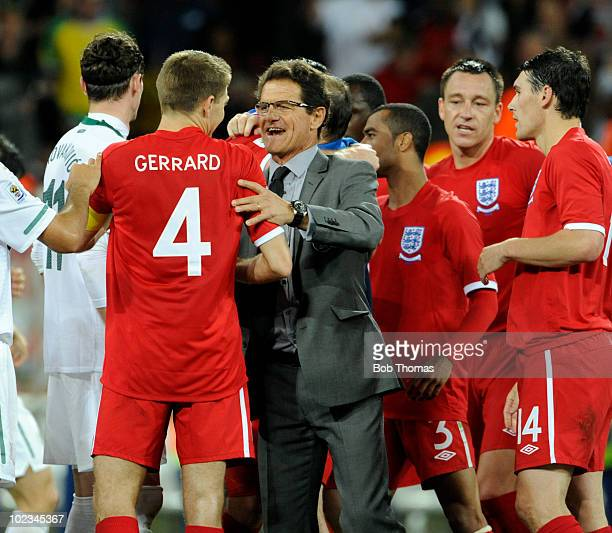 England coach Fabio Capello congratulates England captain Steven Gerrard after the 2010 FIFA World Cup South Africa Group C match between Slovenia...