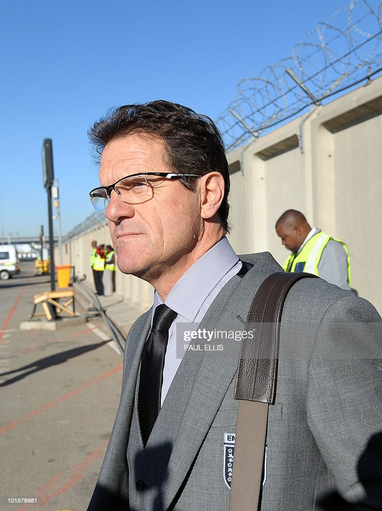 England coach Fabio Capello from Italy arrives at Johannesburg Airport in South Africa for the 2010 Football World Cup Finals on June 3, 2010. The team will transfer to their hotel and training base at the Bafokeng Sports Campus near Rustenburg, ahead of their opening game against USA on June 12.