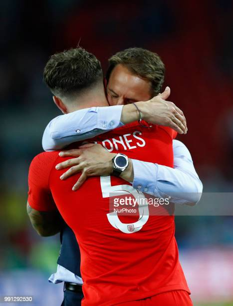 England coach Gareth Southgate celebrates with John Stones of England the victory after the penalty shootout of the 2018 FIFA World Cup Russia Round...