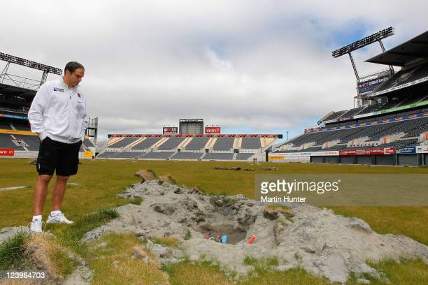 England coach Martin Johnson inspects earthquake damage on the field during a England IRB Rugby World Cup 2011 squad visit to AMI Stadium on...