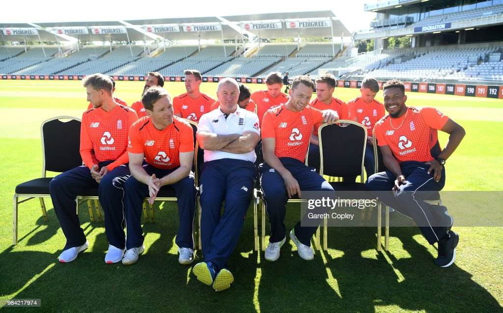 England coach Paul Farbrace sits with his team as they wait for a team photograph to be taken at Edgbaston on June 26, 2018 in Birmingham, England.