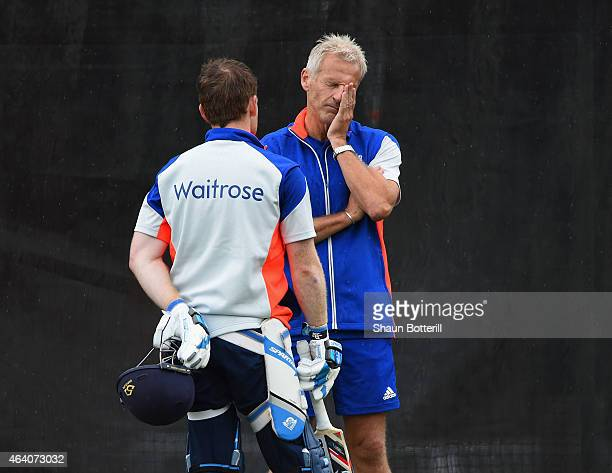 England coach Peter Moores talks with captain Eoin Morgan during an England nets session at Hagley Park Oval on February 22, 2015 in Christchurch,...