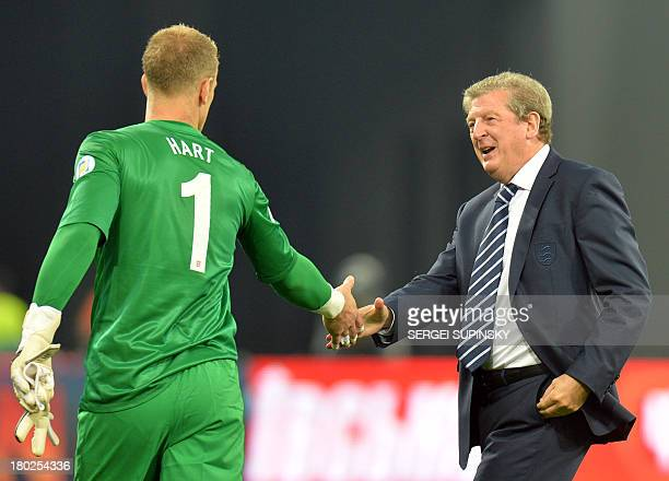 England coach Roy Hodgson thanks to the goalkeeper Joe Hart after the Brazil 2014 FIFA World Cup qualifiers Group H football match with Ukraine in...
