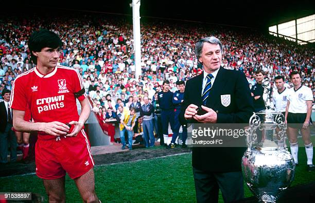 England coach Sir Bobby Robson hands a Barclays League Division One winner's medal to Alan Hansen of Liverpool as England players look on in advance...
