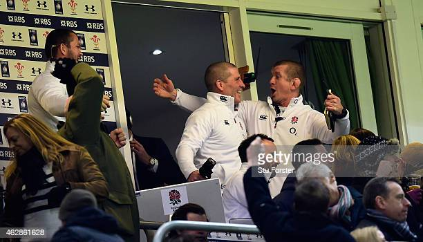 England coach Stuart Lancaster and Graham Rowntree celebrate victory from their box during the RBS Six Nations match between Wales and England at...