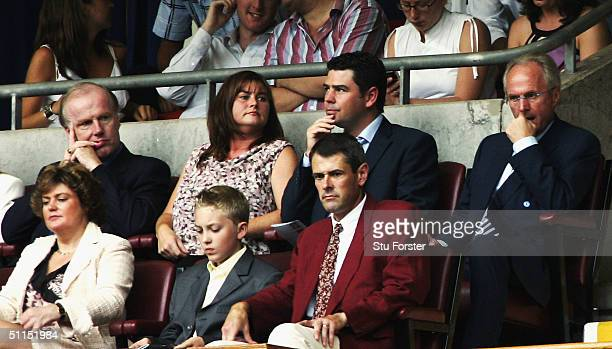 England coach Sven Goran Eriksson and David Davies look on during the FA Community shield match between Arsenal and Manchester United at the...